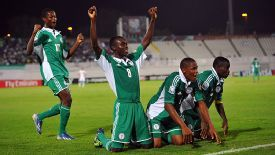 Nigeria players celebrate a goal in the victory against Iran.