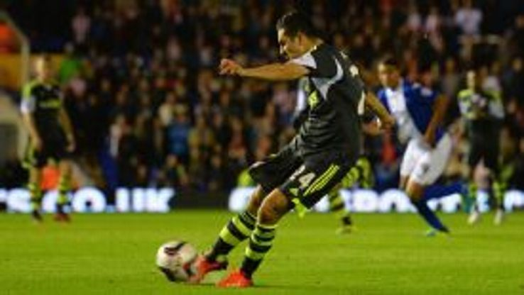 Oussama Assaidi set Stoke City on their wayt to a Capital One Cup victory over ten-man Birmingham