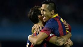 Cesc Fabregas celebrates with Alexis Sanchez after providing the assist for Barcelona's opener.