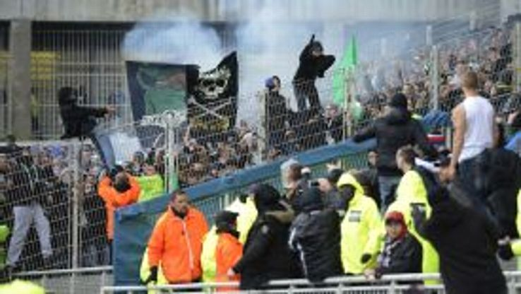 St Etienne and Lyon fans clash during April's derby at the Stade Gerland.