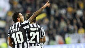 Carlos Tevez celebrates after bagging Juve's fourth goal in their rout of Catania.