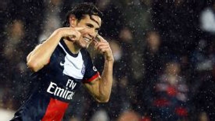 Edinson Cavani celebrates his first goal in PSG's rout of Lorient.