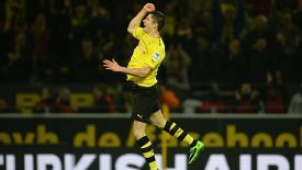Robert Lewandowski jumps for joy after scoring against Stuttgart.
