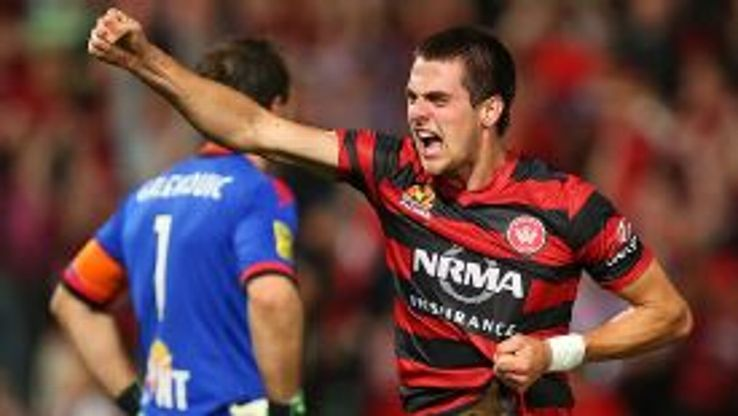 Tomi Juric celebrates the winner against Adelaide.