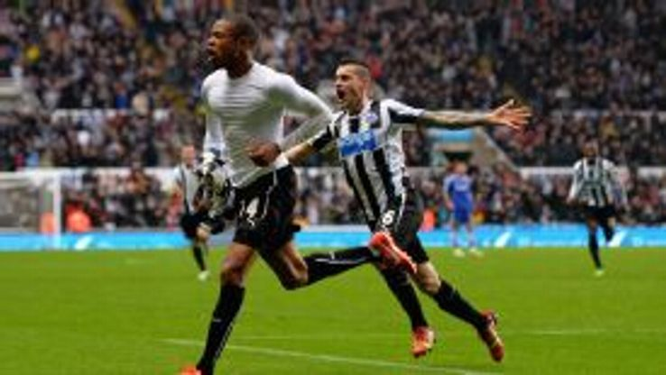Loic Remy wheels away after wrapping up Newcastle's win over Chelsea.
