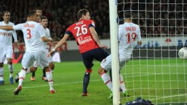 Nolan Roux scored twice to give Lille victory against Monaco.
