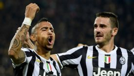 Arturo Vidal celebrates after firing Juventus ahead from the penalty spot.
