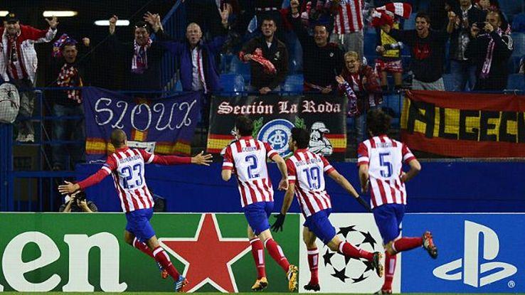 Atletico Madrid celebrate after Miranda gave them the lead against Austria Vienna.