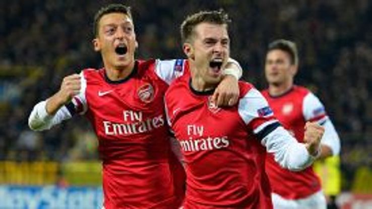 Goalscorer Aaron Ramsey celebrates with Mesut Ozil after he gave Arsenal the lead at Dortmund.