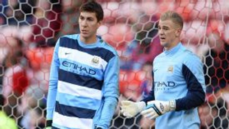 Costel Pantilimon and Joe Hart warm up.