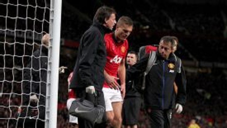 Nemanja Vidic leaves the field after suffering a head injury.