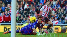 Phil Bardsley slots the ball home.