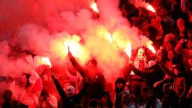 Poland fans lit flares during their World Cup qualifier at Wembley on Oct. 15.