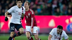 Christian Eriksen goes to ground under a challenge against Norway.