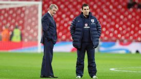 Roy Hodgson and Gary Neville inspect the pitch.