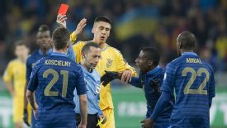 Laurent Koscielny is shown a red card during France's 2-0 defeat to Ukraine.