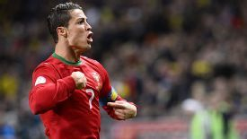 Cristiano Ronaldo celebrates after scoring his first in Sweden.