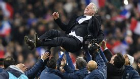 Didier Deschamps is thrown into the air after masterminding France's comeback against Ukraine.