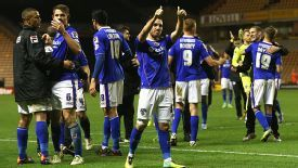 Oldham celebrate at the final whistle after knocking out Wolves at Molineux.