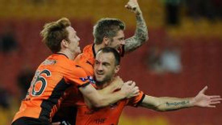 Ivan Franjic celebrates his strike with his Brisbane Roar team mates.