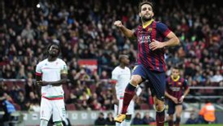 Cesc Fabregas jumps for joy after slotting home Barcelona's second successful penalty against Granada.