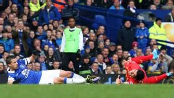 Luis Suarez howls in pain after being caught in a challenge with Kevin Mirallas.