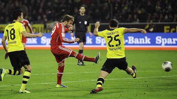 Mario Goetze fires Bayern Munich into the lead on his old stomping ground.