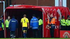 Wes Brown heads for the tunnel after being controversially sent off at Stoke City.