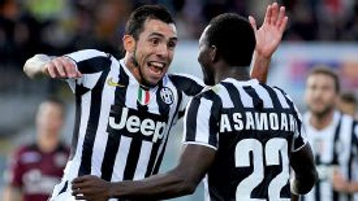 Carlos Tevez celebrates with Kwadwo Asamoah after wrapping up the victory.