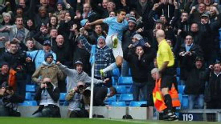 Jesus Navas celebrates after giving Manchester City a very early lead.