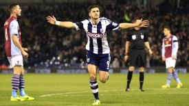 Shane Long celebrates after netting his opening goal against Aston Villa.