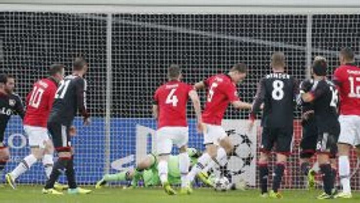 Jonny Evans scores to increase Manchester United's lead against Leverkusen.