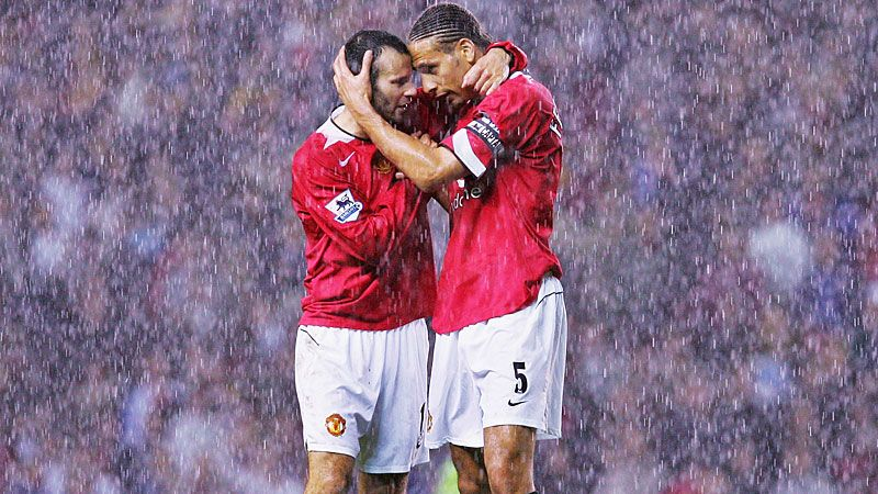 Ryan Giggs and Rio Ferdinand embrace after a 2-0 win over Arsenal in October 2004.