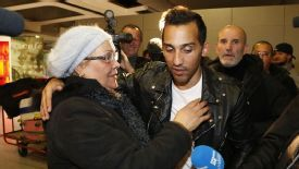 Zahir Belounis greets his mother at the airport after his arrival in Paris.