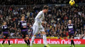 Gareth Bale heads home the first of his hat trick against Valladolid.