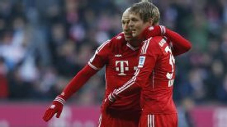 Arjen Robben and Toni Kroos celebrate during Bayern Munich's Bundesliga game against Braunschweig.