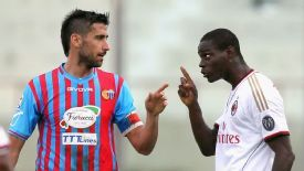 Nicolas Spolli and Mario Balotelli exchange words during AC Milan's win at Catania.