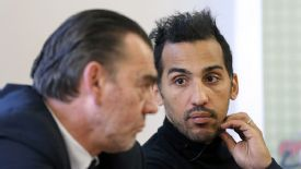 Zahir Belounis attends a news conference with his lawyer in Paris.