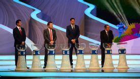 Mario Kempes, Lothar Matthaus, Fernando Hierro and Alcides Ghiggia prepare to make the World Cup draw.