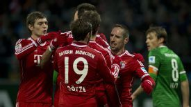 Bayern Munich celebrate after Franck Ribery scored their third of the game.