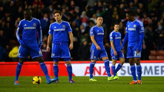 Chelsea players show their frustration after falling 3-2 behind in injury time at Stoke.