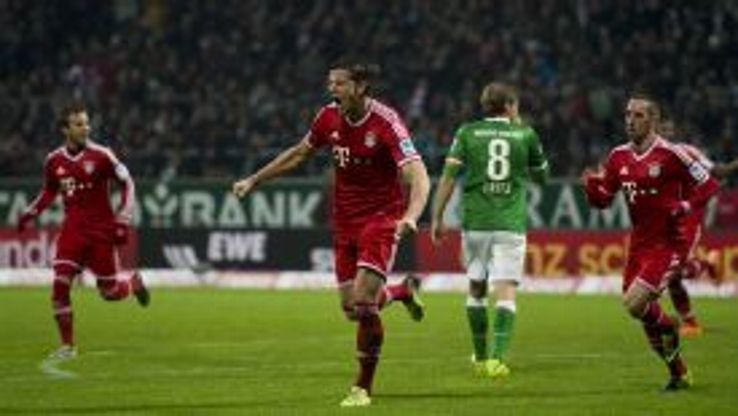 Daniel Van Buyten celebrates after heading home Bayern's second goal.