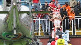 A fan is taken on a stretcher from the stands to a waiting air ambulance.