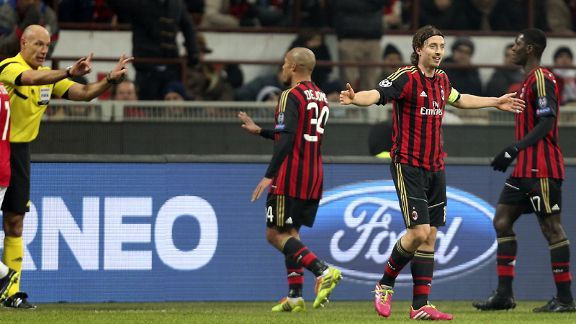 Riccardo Montolivo reacts to his red card at the San Siro.
