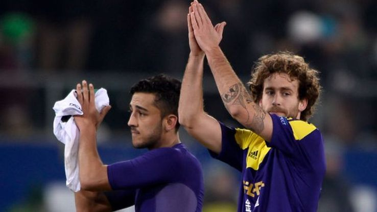 Neil Taylor and Jose Alberto Canas salute the Swansea fans after their loss at St Gallen.