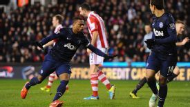 Patrice Evra celebrates scoring the goal that put Man Utd out of site against Stoke.