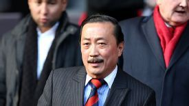 Cardiff City chairman Vincent Tan takes his seat at Anfield