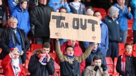 Cardiff fans show a sign with 'Tan Out'