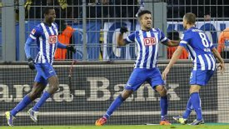 Hertha Berlin celebrate after Sami Allagui (c) scored their winner at Borussia Dortmund.