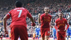 Luis Suarez calebrates with Jordan Henderson after the midfielder's backheel set him up for his second goal.
